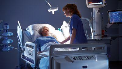 System-Nurse-with-Patient-in-ICU-Unit.jpg