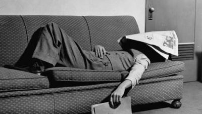paul-dorsey-writer-niven-busch-lying-on-sofa-with-newspaper-over-his-face-as-he-takes-nap-from-screenwriting_a-G-3598081-4990704.jpg